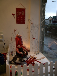Kidsen window with sleigh looking out onto street