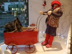 Kidsen window with vintage pram and gorgeous childrenswear