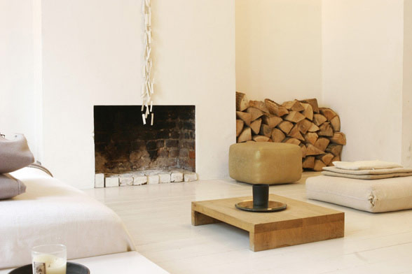 white fireplace with wood
